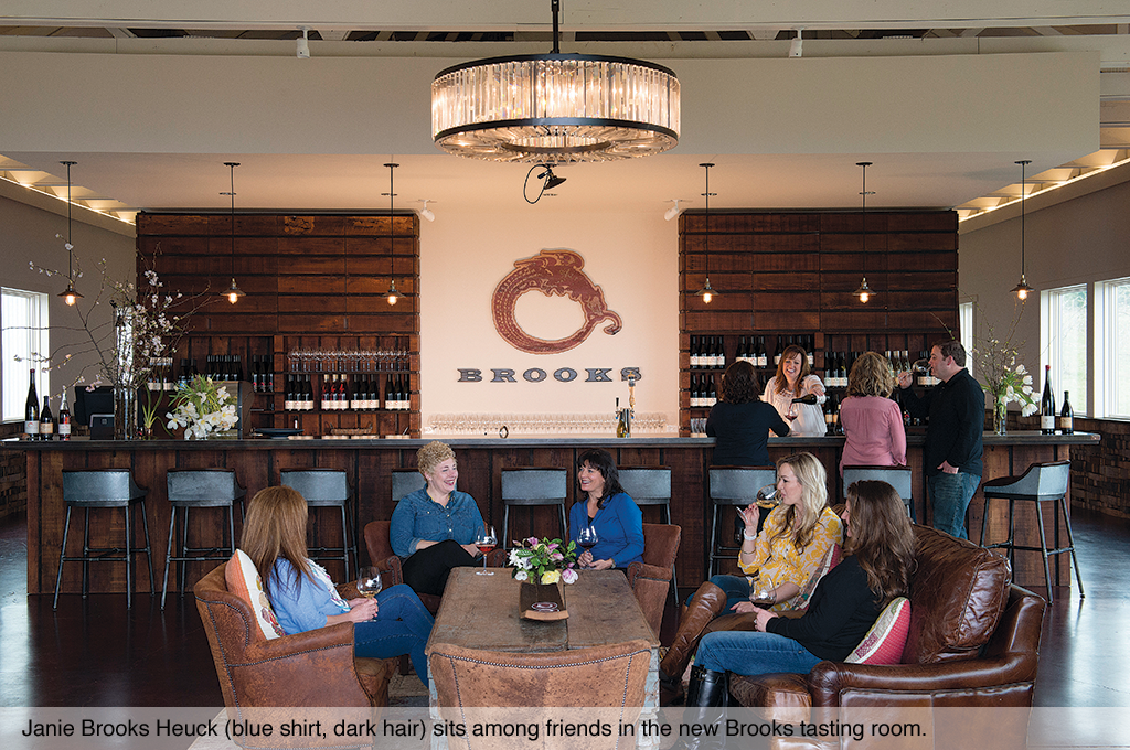 Janie Brooks Heuck (blue shirt, dark hair) sits among friends in the new Brooks tasting room.