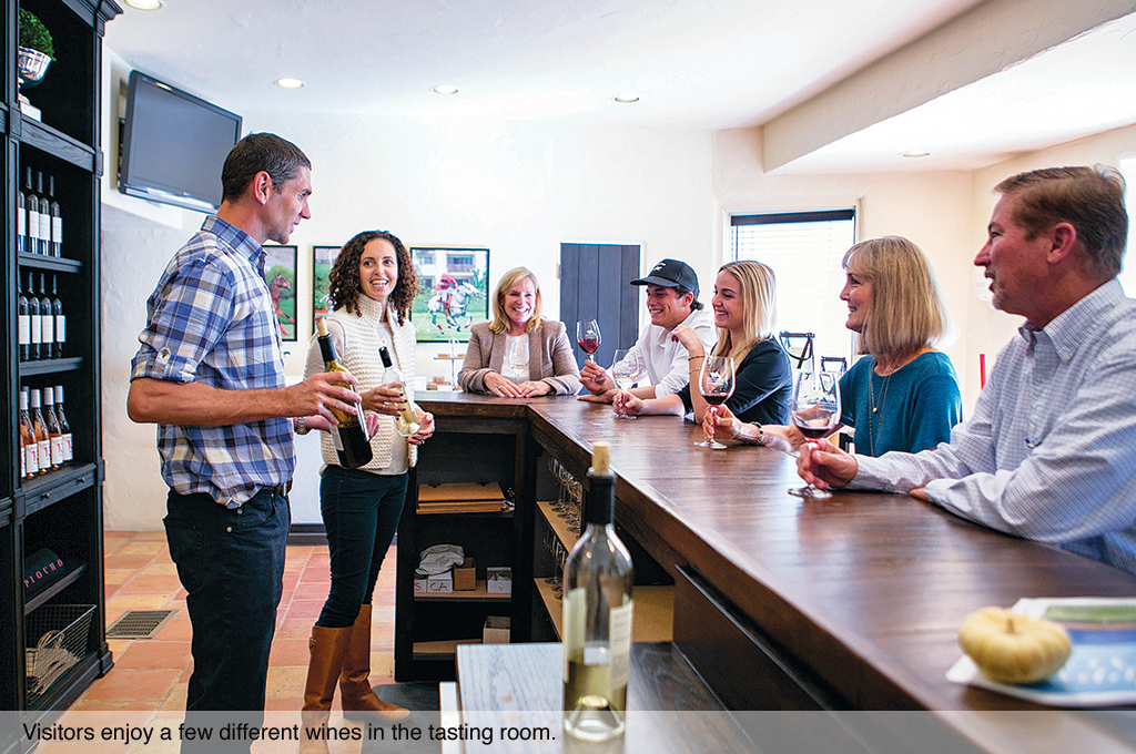 Visitors enjoy a few different wines in the tasting room.