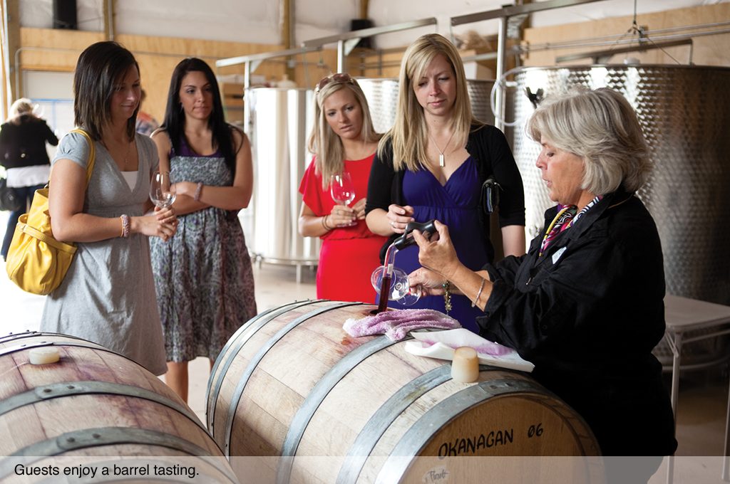 Guests enjo a barrel tasting.