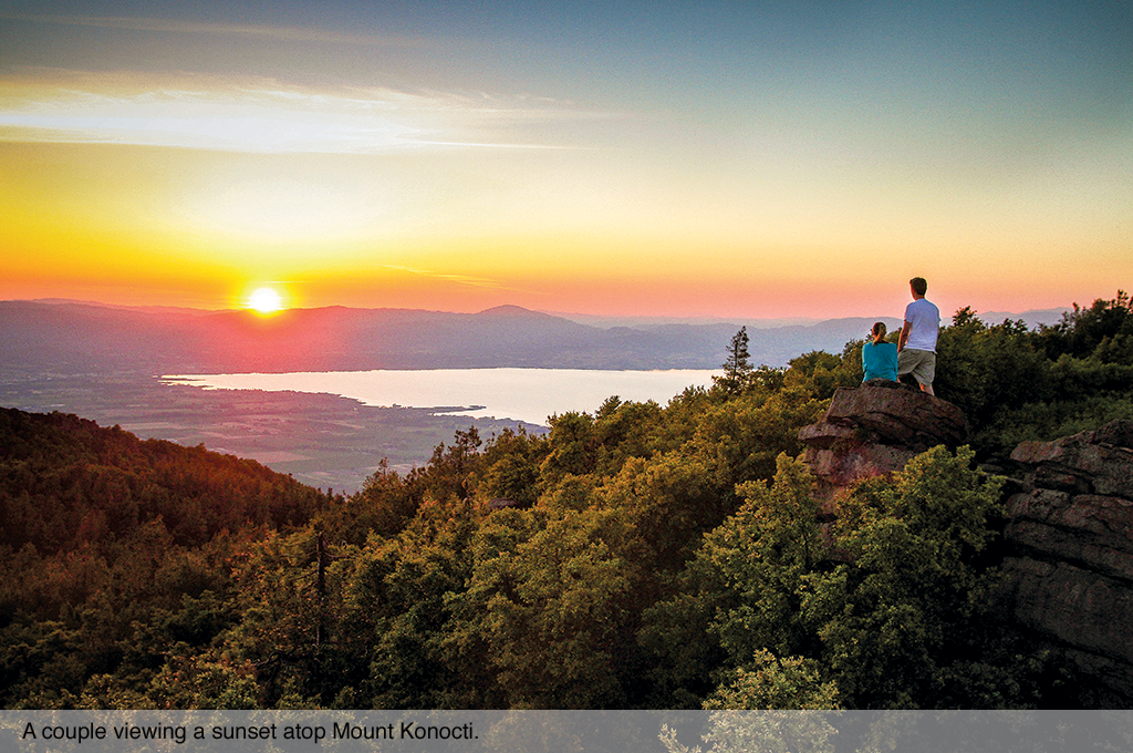 A couple viewing a sunset atop Mount Konocti.