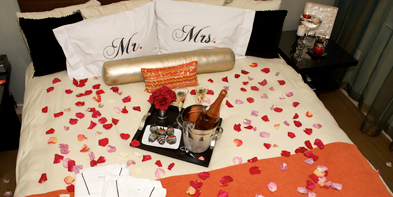Some Candles Flower Petals And A Bottle Of Bubbly Can Be Quick Start To Romantic Weekend In Bed